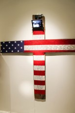 This installation included a cross hung in the american flag was inscribed with racial slurs