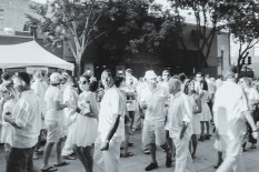 The NOLA art community out in their best summer whites to tour the galleries on Julia Street
